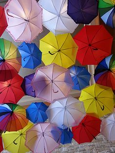 day of spring decorations idea-- Hanging bright colorful umbrellas from the ceiling to welcome in the new season and brighten any entrance way. 1st Day Of Spring, Spring Is Here, Colorful Umbrellas, Spring Decorations, Entrance Ways, Ceiling, Bright, Seasons, Decorating