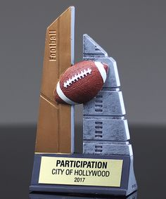 The Skytower Football Award measures in height and features a modern gender neutral look with embossed details. Football Trophies, Football Awards, Gender Neutral, Messages, Text Conversations