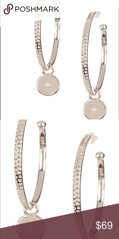 "Savvy Cie 1"" Diamond Drop Earrings FEATURES Available in 18K White Gold Vermeil prong set faceted round diamond charm hoop earrings Post back 1.5 drop Care: Wipe clean with a soft, dry cloth INCLUDED IN THE BOX 1x Savvy Cie 1"" Diamond Drop Earrings Jewelry Rings"
