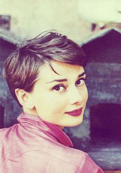 Audrey Hepburn pixie cut, pink blouse and burgundy lipstick.