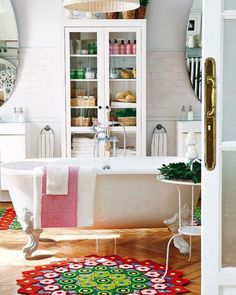 featured on iwantthat, this white bathroom has been effectively accessories to create a colourful space