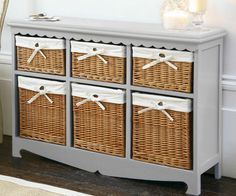 Use an old dresser as a sideboard. Take out the drawers and use them as shelves, and place baskets