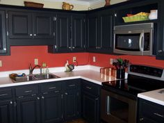 Black cabinets & red walls. Its definitely a maybe for my kitchen