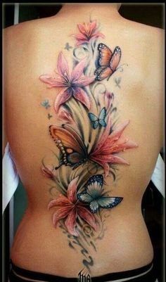 chic butterfly and lily watercolor tattoo on spine