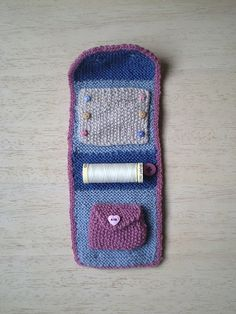This little fold up sewing kit holds a pair of folding scissors, a reel of thread and some needles and pins. It is small enough to fit in a handbag and would be ideal to carry when travelling.