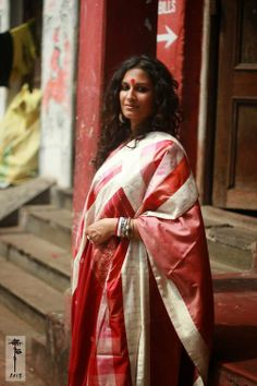MORA.  Traditional Bengali styling - shankha pola (coral and conch bracelets), big red bindi, white and red sari. LOVE!