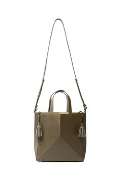 The Bone Bag is inspired by the simple act of folding a piece of paper into a continuous form, much like origami.