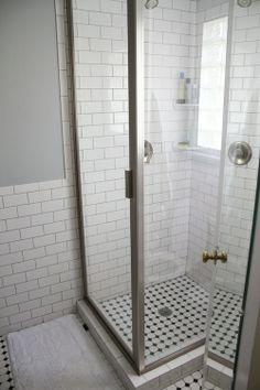 bathroom redo. vintage/modern. glass shower. gray grout. subway tile.