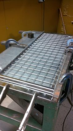 Stainless steel mesh and CNC punched frame clamped onto a welding bench waiting to be TiG welded http://www.vandf.co.uk/gallery/welding-fabrication/