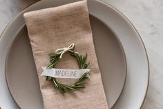 This placesetting by Spoon Fork Bacon—complete with rosemary wreath placecards tutorial—is the ultimate in Scandinavian simplicity.