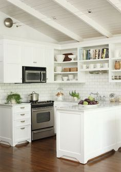 small but functional - I like the white tiles and cabinets with the dark floor.