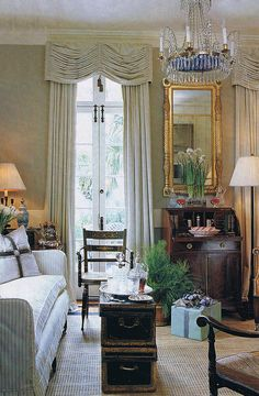 drapes and chandelier  well proportioned room