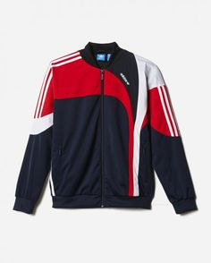 'A look from the archives resurrected. This training jacket for women has a curved cuts inspired by a model from 1994 taken from adidas archives. It is made of tricot sporty with attached panels of pleated nylon, which gives an authentic retro feel.' - Adidas  Details: Front pockets with zipper Full length zip with stand-up collar; Ribopslag and nails Colourblocked panels; Asymmetric 3-Stripes on sleeves pieces and the right side of the body portion; Mesh for Printed horizontally Trefoil…