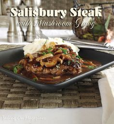 Salisbury Steak with Mushroom Gravy | Taking On Magazines | www.takingonmagazines.com | These perfectly cooked beef patties are covered in a silky smooth mushroom sauce. Comfort food and decadence combined.
