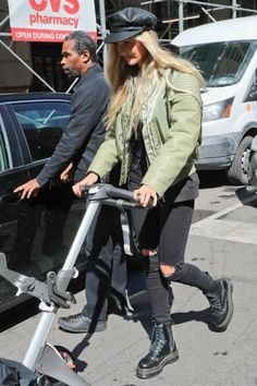 Candice Swanepoel wearing Dr. Martens Jadon Boots and Givenchy Zip Hoodie in Black