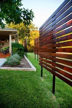 Contemporary Landscape Privacy Screen. Consider putting up screens instead of fences if you are on a budget. Screens can be really effective barriers to roadways or other public views.: