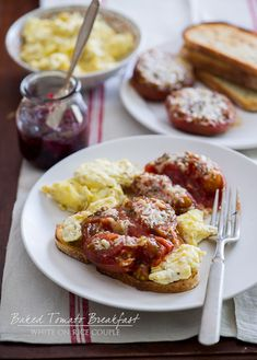 Baked tomatoes with parmesan cheese, scrambled eggs on toast
