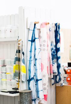 Scarves and test swatches hang in Joanna's colourful studio.  Photo - Phu Tang.