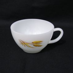 Vintage Fire King Wheat Cup. This translucent white #cup features a wheat pattern on one side and a handle. This product was discontinued in the 1960's. It is in great condition with no chips or cracks. Check out the matching sugar bowl also for sale at Macho Machismo Vintage.    On the bottom it states: Fire King * OVEN WARE * 24 * MADE IN U.S.A. *