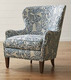 An overscaled paisley print makes the Brielle wing chair an instant statement piece for the living room. Comfortable and conversation-worthy, this updated, classic wingback chair is outlined by hand-applied, platinum-finished nailheads that trace every curve.