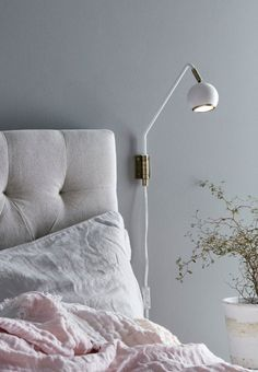 Elegant and stylish lamp, with its simple details of brass giving it a slim and feminine look. The design is classic and the soft form helps to provide a feeling of peace in the room.