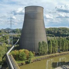 I.M. Cooling Tower: Location: Monceau, Belgium Year of Construction: 1921   A tower used to cool up to 480,000 gallons a minute, is now a part of a large abandoned water plant.