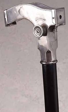 vintage cane camera—old school private-eye gear, from the 1920s, 30s, 40s