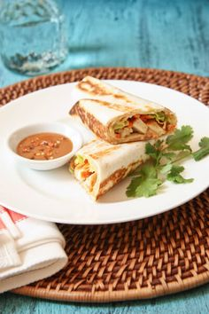 Baked, crispy tortillas surround tender chicken, carrots, scallions and lettuce for a crunchy, springroll like wrap that dipped into a spicy peanut sauce.