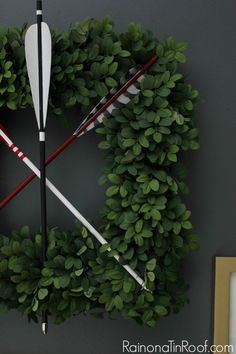 The arrows add a playful touch to the boxwood wreath. Via @Jenna @ Rain on a Tin Roof