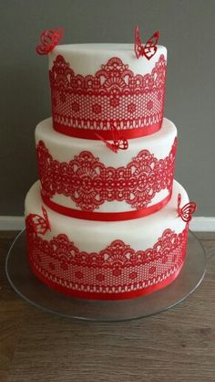 Wedding cakes with red lace
