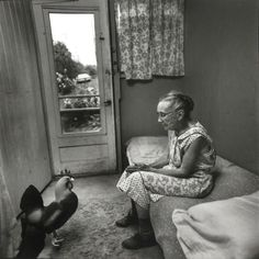 Charlotte Olds and rooster, NY, 1975 - by Arthur Tress (1940), USA