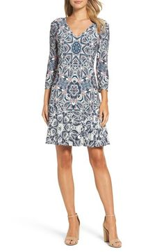 Free shipping and returns on Eliza J Print Knit Dress (Petite) at Nordstrom.com. A placed print featuring heart- and star-infused paisley covers a stretchy knit dress detailed with a pretty V-neckline and three-quarter sleeves.