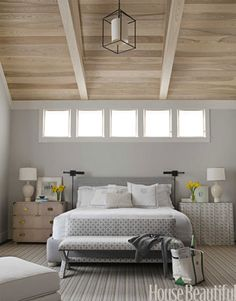 Designer Ann Wolf used quiet colors in this master bedroom, painting the walls Benjamin Moore's Gray Owl. Photo: Reed Davis. housebeautiful.com. #bedroom #gray #bench #ottoman