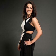 World Wrestling Entertainment (WWE) professional wrestler Bayley wearing a white and (&) black outfit.