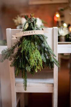 gathered greenery for the back of chairs
