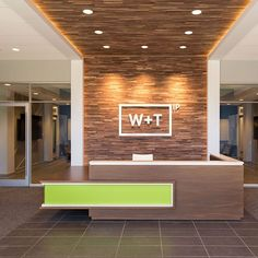 A modern reception desk with a vibrant Chroma accent welcomes visitors to this law office. Dental Office Design, Modern Office Design, Healthcare Design, Office Interior Design, Office Interiors, Modern Offices, Office Designs, Modern Reception Desk, Reception Desk Design