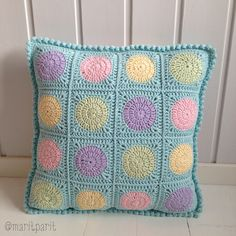 Crochet cushion cover! Pretty pastels and pom poms.