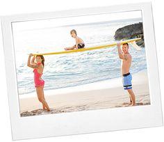 Hawaii family with surfboard on the beach (Windward Skies Photography) ;-)