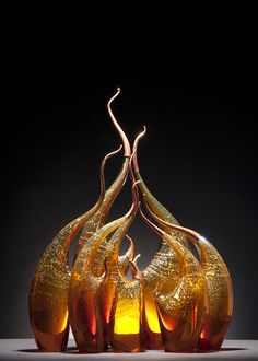 Dynamic glass sculptures by Rick Eggert capture some of the basic Earth elements - wind, water, and fire.