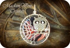 This owl pendant features a genuine carnelian stone, gold plated copper wire, and a lead-free owl charm that has topaz Swarovski chaton crystals