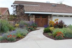 Roger's Gardens – CA Friendly Design Ideas. (I would love for my front yard to look similar to this. NO GRASS.)