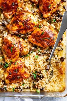 Easy Oven Baked Chicken And Rice With Garlic Butter Mushrooms mixed through is winner of a chicken dinner! Chicken thighs bake on top of buttery, garlicky, soft and tender rice with crispy edges. ALL the chicken flavours bake right in! Dinner doesn't get any easier!