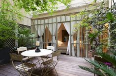 Bedroom opening on to a garden, in the heart of Paris. Perfect.