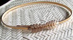 Cinturón dorado elástico. 9,03€ -CMK