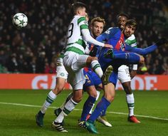 Celtic's Danish defender Erik Sviatchenko (L) vies with Barcelona's Portuguese midfielder Andre Gomes (R) during the UEFA Champions League group C football match between Celtic and Barcelona at Celtic Park in Glasgow on November 23, 2016. / AFP / Paul ELLIS