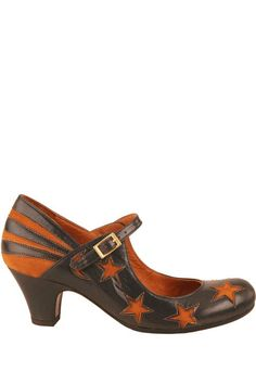 black leather low heels with cutout stripes & stars - now these, I might actually wear! too bad they're something like $320