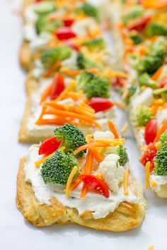 Vegetable Pizza is the ultimate party food: Always a hit, never any leftovers! It's also the tastiest way to eat vegetables, ever.