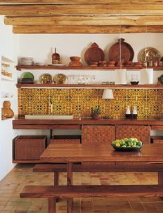 Rustic kitchen with modern influences. Unusual, but could work in a beachy Spanish Revival remodel.