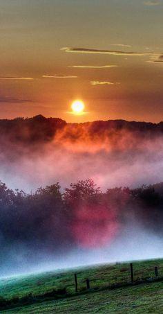 Amazing colorful nature mist mountain sunrise Asmannskotten, Germany