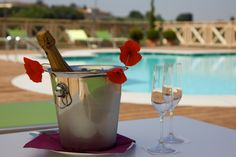 A glass of sparkling wine by the pool
